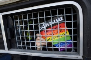 "Activist detained in Russia.  The sign says, ""Love is stronger than homophobia.""  I hope so."
