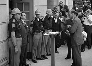 Attempting to stop integration at the University of Alabama, Governor of Alabama George Wallace stands at the door of the Foster Auditorium while being confronted by United States Deputy Attorney General Nicholas.